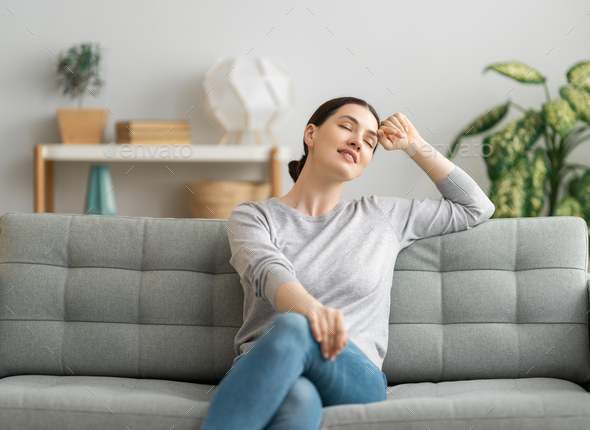 woman resting on sofa at home - Stock Photo - Images