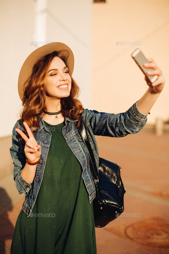 Brunette making duck face and taking self portrait - Stock Photo - Images