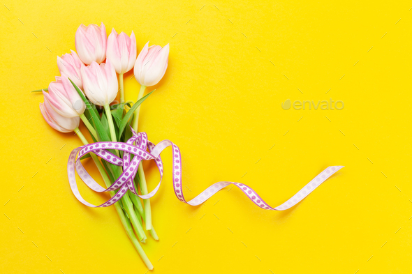 Pink tulips over yellow background - Stock Photo - Images