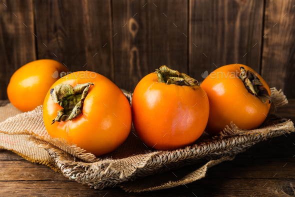 Delicious ripe persimmon fruit - Stock Photo - Images