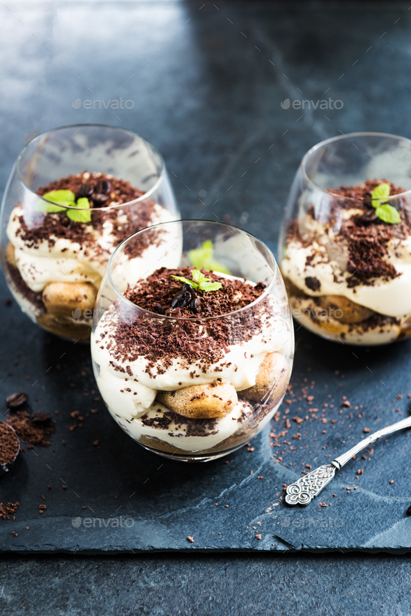 Traditional Italian dessert Tiramisu in a Glass Jar - Stock Photo - Images