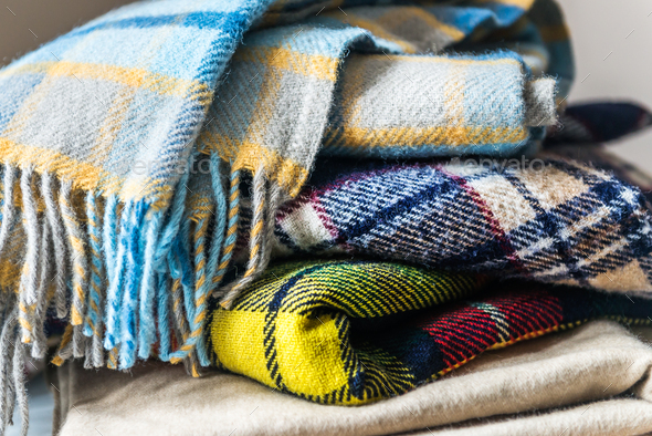 Stack of woolen checked blankets - Stock Photo - Images
