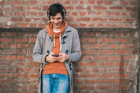 Young man using his mobile phone. - Stock Photo - Images