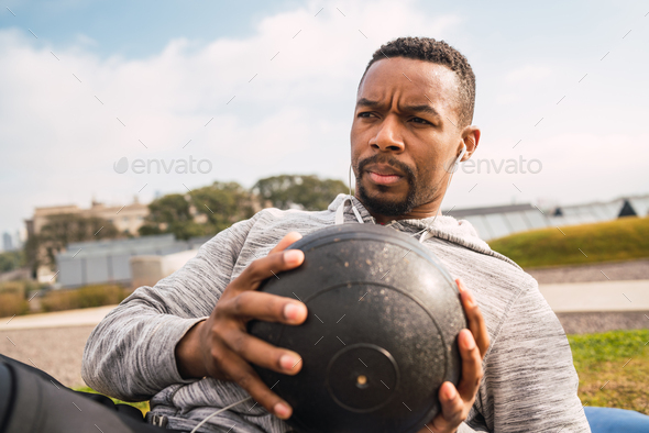 Athletic man doing exercise with medicine ball. - Stock Photo - Images