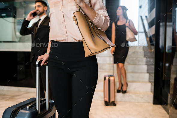 Business people arriving at hotel. - Stock Photo - Images