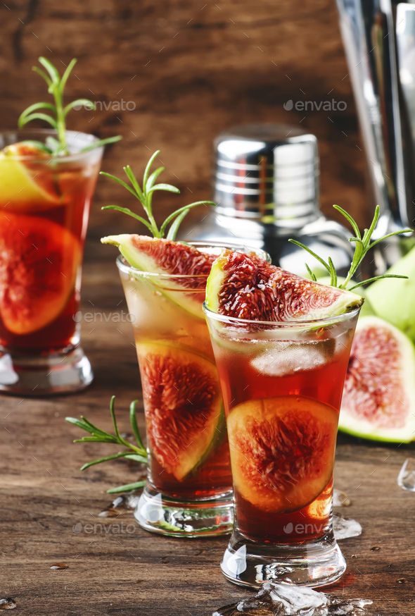 Red cocktail with cognac, liquor, lime juice, figs and honey - Stock Photo - Images