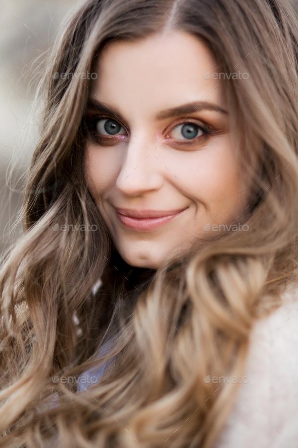 Beautiful girl with wavy hair perfect make up and long eyelashes - Stock Photo - Images