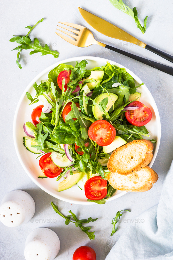 Green salad from leaves and vegetables - Stock Photo - Images