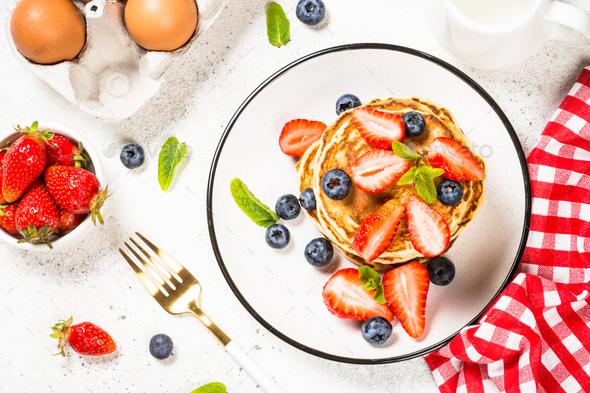 Pancakes with fresh berries and honey - Stock Photo - Images