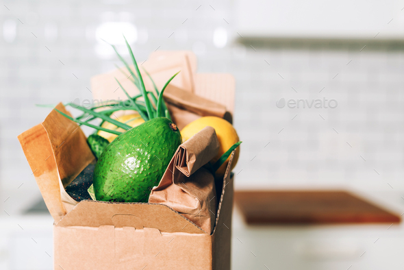 Donation box with healthy food on white kitchen background. Copy space. Food delivery service during - Stock Photo - Images