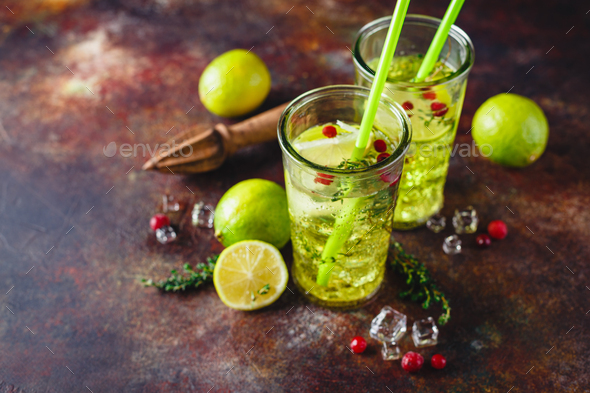 Lime Lemonade with thyme, cranberry and ice. - Stock Photo - Images