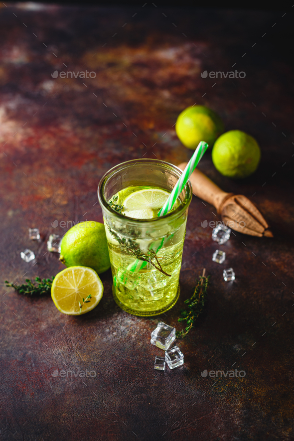 Lime Lemonade with thyme and ice. - Stock Photo - Images