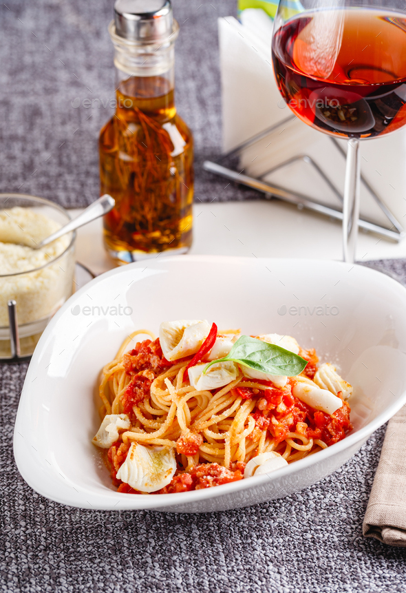 Pasta with squid and tomatoes - Stock Photo - Images