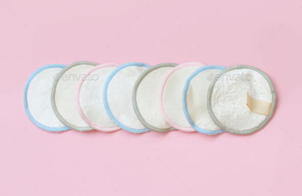Eco friendly reusable make-up remover pads on pink background - Stock Photo - Images