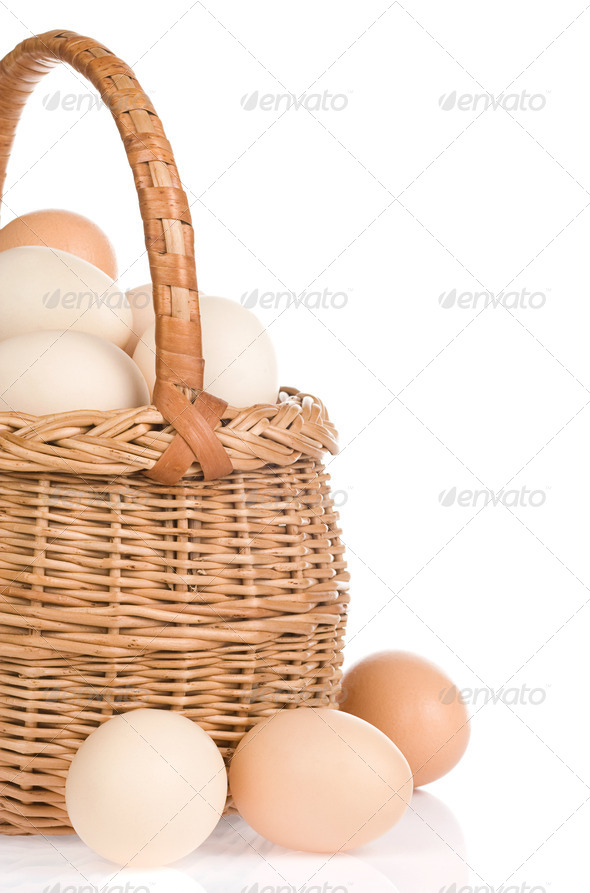 eggs and basket on white background - Stock Photo - Images