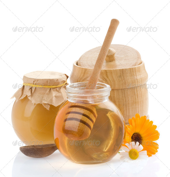 jar of honey and flowers - Stock Photo - Images