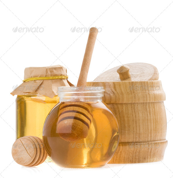 glass pot of honey and stick - Stock Photo - Images
