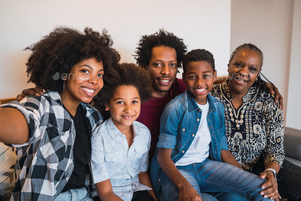 Multigenerational family taking selfie at home. - Stock Photo - Images