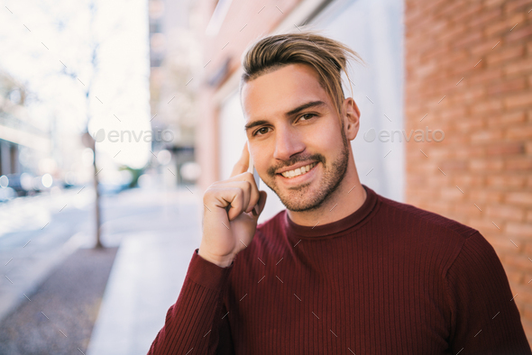 Man talking on the phone outdoors. - Stock Photo - Images