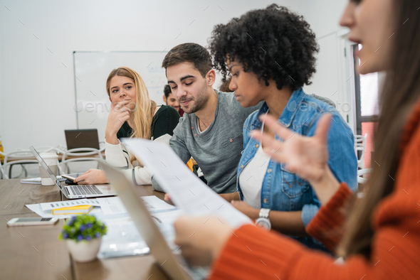 Creative designers working in a project together. - Stock Photo - Images