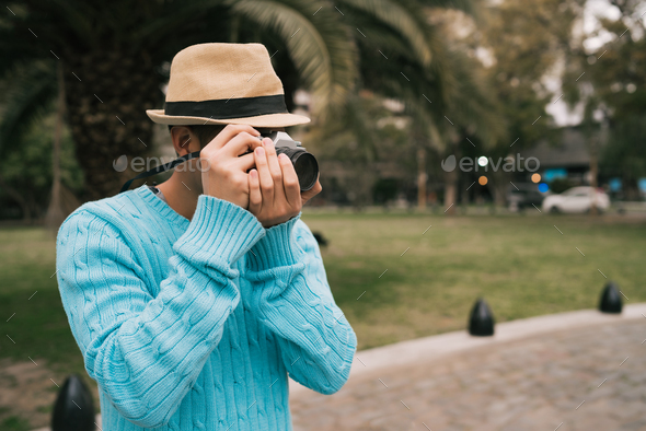 Asian tourist with a vintage camera. - Stock Photo - Images