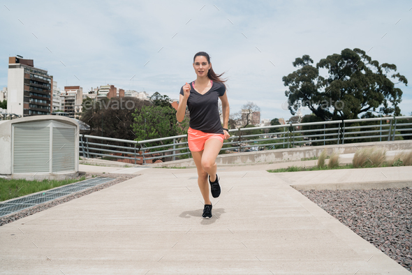 Portrait of fitness woman running. - Stock Photo - Images