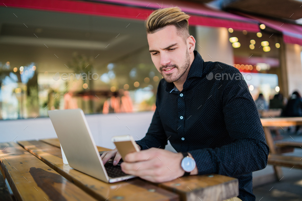 Businessman working on his laptop. - Stock Photo - Images