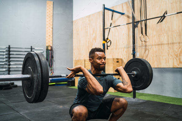 Crossfit athlete doing exercise with a barbell. - Stock Photo - Images