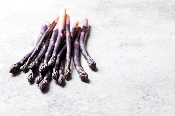 Fresh purple asparagus. Healthy eating concept. Food for vegetarians. - Stock Photo - Images