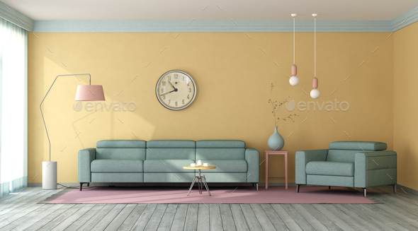 Blue sofa and armchair in a living room with yellow walls - Stock Photo - Images