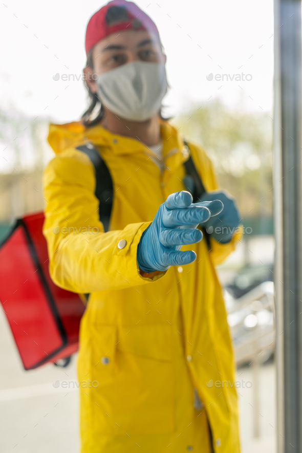 Delivery man in gloves - Stock Photo - Images