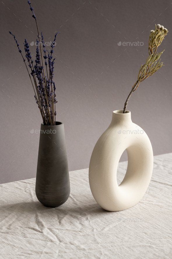 Still life composition with two ceramic handmade vases with dried wildflowers - Stock Photo - Images