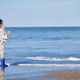 Cute girl wearing rubber boots next to the ocean - PhotoDune Item for Sale