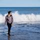 Happy woman having fun at the ocean - PhotoDune Item for Sale