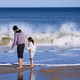 Happy mother and daughter next to the ocean - PhotoDune Item for Sale