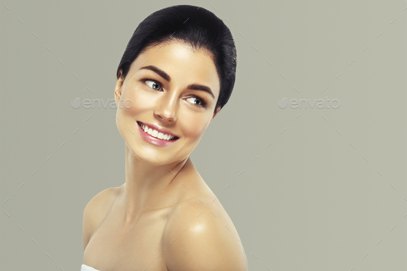 Woman cosmetic closeup beauty portrait, healthy care skin hair over gray color background - Stock Photo - Images