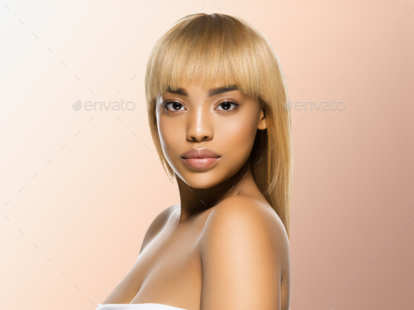 Black skin beauty woman healthy hair skin close afro american beautiful model. On beige. - Stock Photo - Images