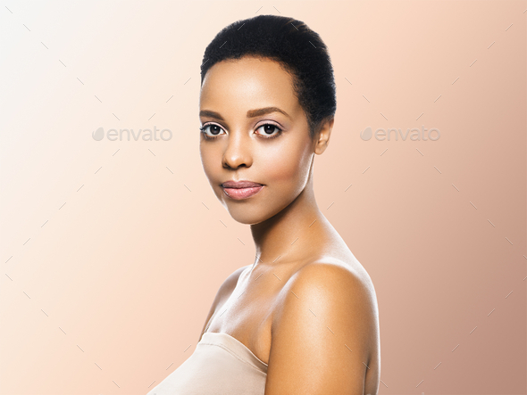 Black skin beauty woman healthyskin teeth and hair model. Beige background. - Stock Photo - Images