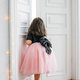 Little girl in beautiful pink dress with tutu skirt looks at door - PhotoDune Item for Sale