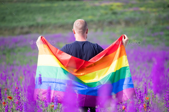 Young man with LGBT flag. - Stock Photo - Images