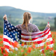 Patriot woman holding the american flag on the 4th of July - PhotoDune Item for Sale