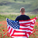 Patriot man holding the american flag on the 4th of July - PhotoDune Item for Sale