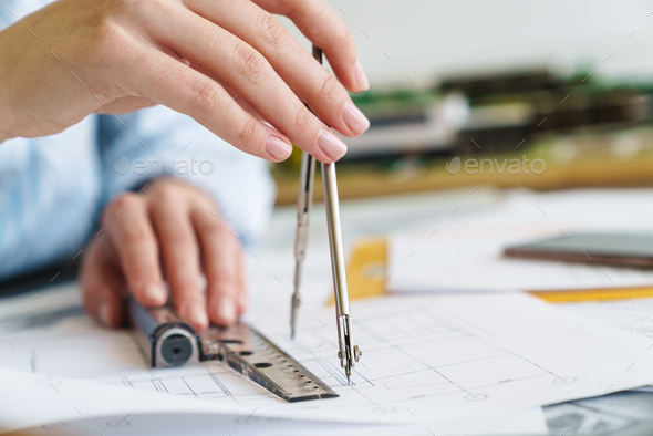 Cropped photo of woman architect making drawing with compass - Stock Photo - Images
