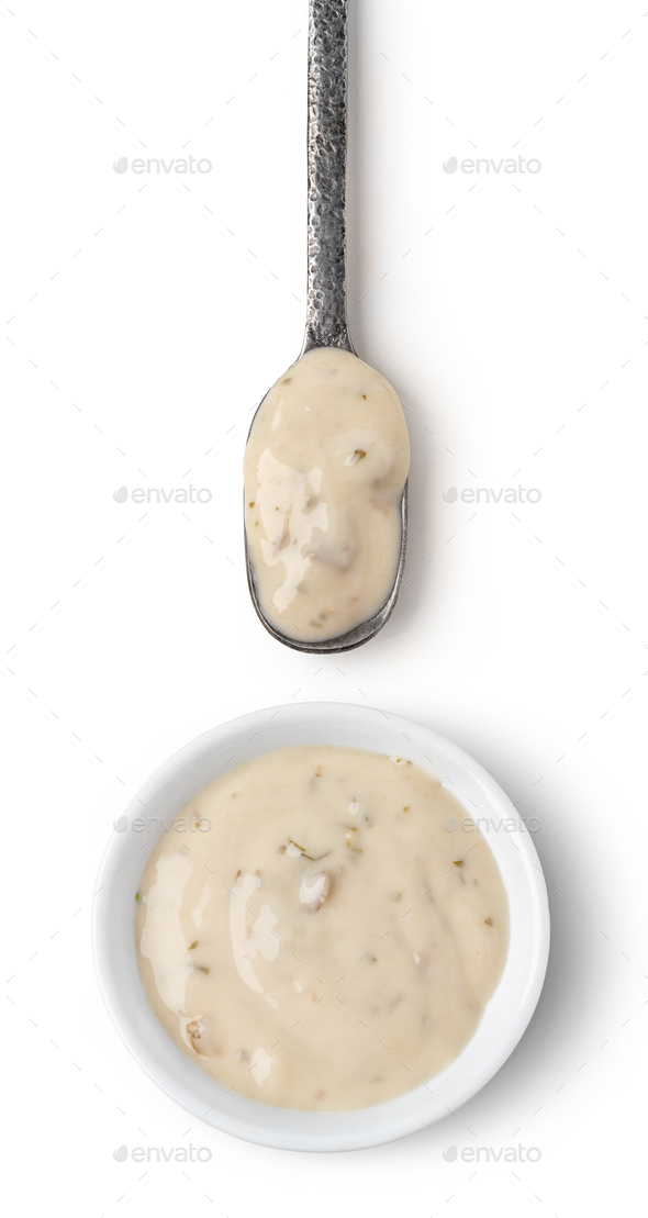 Bowl and spoon with mushrooms sauce - Stock Photo - Images