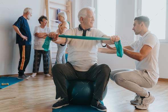 Exercising on a ball - Stock Photo - Images