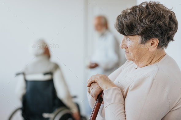 Woman with walking stick - Stock Photo - Images