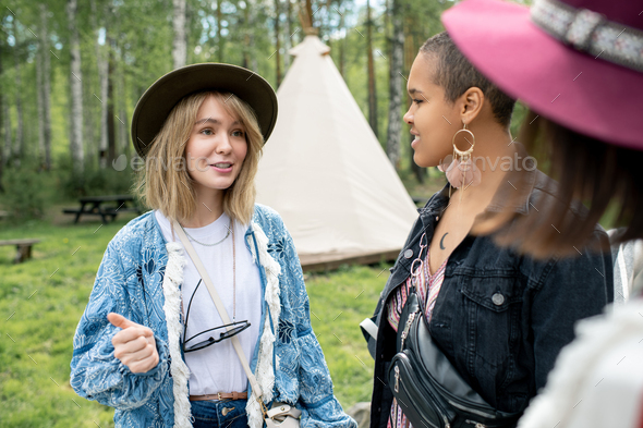 Chatting with friends at campsite - Stock Photo - Images