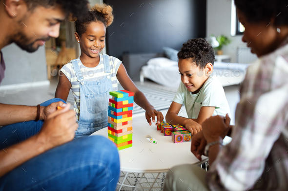 Happy family playing and having fun together at home - Stock Photo - Images