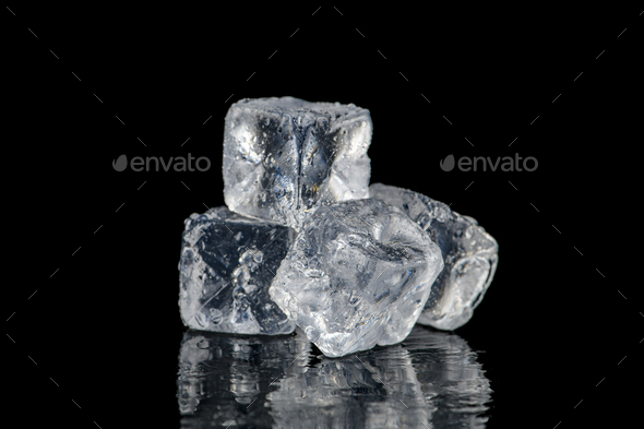 Ice cubes reflection on black table background - Stock Photo - Images