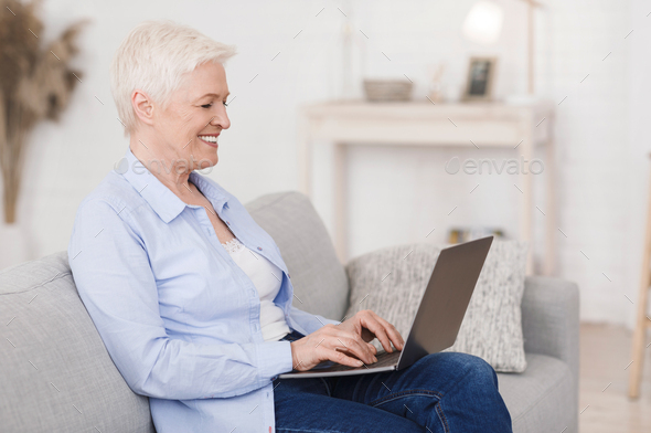 Dating Sites For Seniors. Portrait of elderly lady with laptop at home - Stock Photo - Images